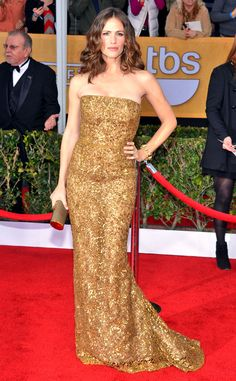 Golden Girl from Jennifer Garner's Best Looks  The 2013 awards season may have been all about her main man, Ben, but his best accessory is definitely his wife! She sparkled in a bronze Oscar de la Renta gown at the Screen Actors Guild Awards that year.