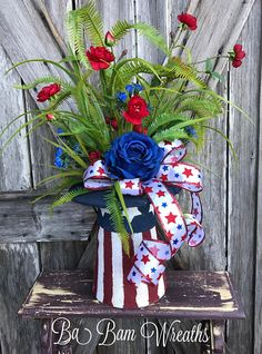 Patriotic Arrangement, Patriotic Centerpiece, Patriotic Floral, Americana Arrangement, 4th Of July Centerpiece, Americana Floral, Patriotic Decor God Bless the USA Make a big bold statement in your home or office with this Patriotic beauty! Made in an Uncle Sam top hat with lush greenery & burst of red/white/blue sprays, bright red roses, stunning Americana ribbons and dainty florals~ this arrangement is a great way to show your American pride. Display on a table, desk, ma...