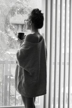 coffee in hand, loose comfy top, morning sun, bun on top