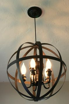 A few weeks ago I showed you the beginnings of our diy chandelier project here . After finishing gluing, rewiring, and painting I am finally...