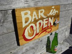 Bar Sign, wooden, hand painted, bottle opener, wall hanging, original art, functional art. $58.00, via Etsy.