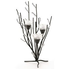Crystal Tree Tealight Holder - Curving black boughs and crystalline berries create an enchanting sparkling display; a trio of tealights placed in the cup-shaped blooms turns this tree into a show of pure splendor! Metal glass and acrylic