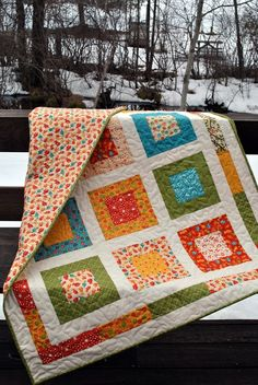 Moda's Lollipop baby or toddler quilt ...pattern also by sweetjane