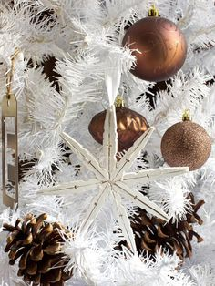 We love this look! Make snowflake ornaments with wooden clothespins. See how: http://www.hgtv.com/entertaining/use-what-you-have-upcycle-household-items-into-holiday-decor/pictures/page-22.html?soc=pinterest