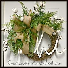 "Farmhouse style grapevine wreath with ""HI"" sign, cotton bolls and greenery by Twentycoats Wreath Creations (2017)"