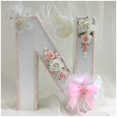 Large letter for nursery or girls room  This pretty shabby chic letter is made from cardboard/papier mache which is very strong and light wreight.  It was painted and then decorated with beautiful roses, pretty butterfly and lots of diamantés, pearl beads, glass beads and hand made bows.  The sides have been painted white and sparkling glitter has been added and then sealed.  This particular letter measures approximately 7 inches in height and is free standing.  It is ready to ship once the…