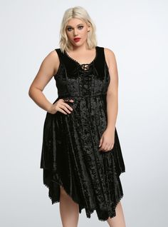 "A dress that Stevie Nicks would totally approve of this is one betwitchin' look. The crushed black velvet dress has crochet lace trim a lace-up front and a hanky style hem. Back zip closure. Model is 5'9"" size 1Size 1 measures 47 1/2"" from shoulderPolyester/spandex/polyurethane/viscoseWash cold dry lowImported plus size dress"