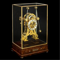 "Grasshopper Clock based on the first marine chronometer made by the clock maker John Harrison (1693-1776). This clock features the ""grasshopper escapement"" operated by two inter-linked pendulums that compensated for the motion of a ship."