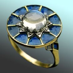 ART NOUVEAU  Superb Ring   Gold Plique-à-jour Moonstone Diamond  Diameter: 1.60 cm (0.63 in)   Marks: Indistinct maker's mark  French, c.1900