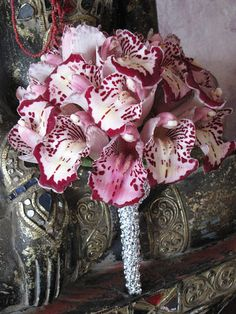Unusual bouquet made from the throat of many cymbidium orchids - San Diego, Coronado, Del Mar, Wedding Florist and Planner   Indian Wedding Planner and Florist
