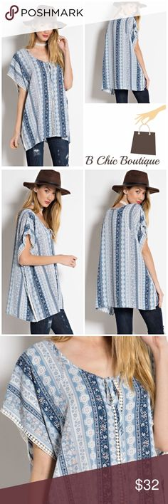 """Ocean Country Blue Tunic Beautiful prints of blue and white tunic top with crochet details running down in the middle. Front tie at the neckline. Made of Poly/ spandex blend.   Measurements  Small Bust 40""""/ length 29""""  Medium  Bust 42""""/ length 29.5""""  Large  Bust 44""""/ Length 30""""  PRICE FIRM - NO TRADES Bchic Tops Tunics"""