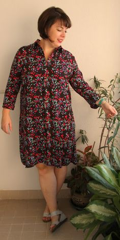 Love this combo: fitted in the shoulders, loose throughout the body, floral shirt dress