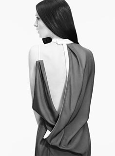 Asymmetrical dress detail with draped silhouette; contemporary fashion // Time