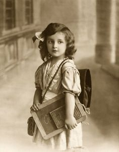 Well kitted school girl of the 1900s
