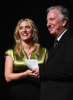 """Actress Kate Winslet (L) and actor/Director Alan Rickman onstage at the """"A Little Chaos"""" premiere introduction during the 2014 Toronto International Film Festival at Roy Thomson Hall on September 13, 2014 in Toronto, Canada."""