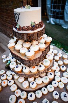 Cake and cupcake tower. My dad would love this- he insists on a cupcake cake at our wedding!
