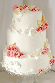 Pretty little wedding cake with small pink roses and small ruffles.   ᘡղbᘠ
