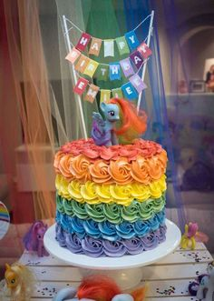 Amazing rainbow cake at a My Little Pony rainbow birthday party! See more party planning ideas at CatchMyParty.com!