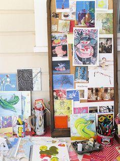 Art postcards, photos, small paintings in progress. Studio of painter Polly Jones.  (Inspiration board/mood board/picture wall, artist studio/office.)