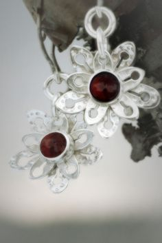 Evergreen Saxifrage  Earrings   Paarma Design  Flowering carpet of tundra species from the end of the Ice Age. Sterling silver and garnet.  120 e  www.paarmadesign.fi Ice Age, Evergreen, Finland, Garnet, Sterling Silver, Unique, Earrings, Design, Jewelry