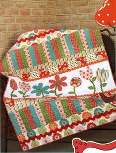 Cute I love this Poppin' Posies quilt designed by my big sis. You are going to want one of these.