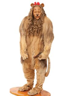 Cowardly Lion Costume From 'The Wizard of Oz'----  Est. sale price: $2,000,000-$3,000,000  Bert Lahr wore the costume -- one of two used in filming -- during the scene in which Dorothy first meets the Cowardly Lion on the Yellow Brick Road. It's actually made of actual Lion skin while the facial makeup on the model is a reproduction based on a cast made using Lahr's son Herbert's face.
