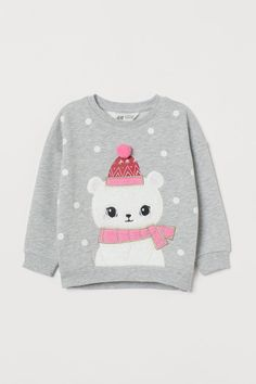 Lightweight sweatshirt with a motif at front. Long sleeves and ribbing at neckline, cuffs, and hem. Gently rounded hem, slightly longer at back. Kids Pjs, Kids Pajamas, Pajamas Women, Baby Girl Fashion, Fashion Kids, New T Shirt Design, Baby Girl Tops, Baby Embroidery, Fashion Company