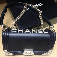 Chanel. Oooh I love this purse. I love bling. The blonde in the pic.