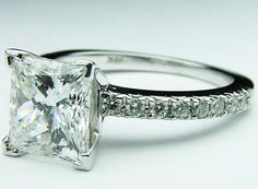 Princess cut Diamond Engagement Ring but without the diamonds on the band.