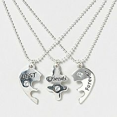 BFF Sparkle Heart Necklace Set from Claire's $12.50 I just realized that this is perfect!!! (i get middle piece, you two get others)