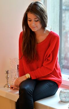 Slouchy red cashmere sweater with black leather jeans
