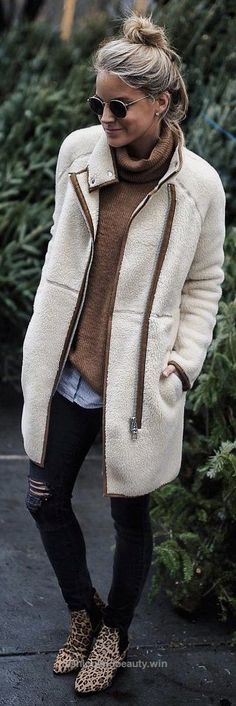Check out this #winter #fashion / White Coat / Brown Knit / Ripped Skinny Jeans / Leopard Booties The post #winter #fashion / White Coat / Brown Knit / Ripped Skinny Jeans / Leopard Boot… app ..