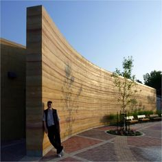 Rammed earth wall constructed with limestone tailings.