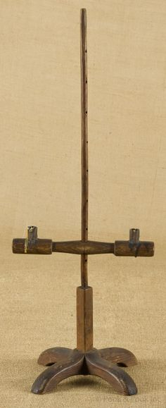 "Primitive table top adjustable candlestand, 18th c., with crossed shoe feet, 25 1/2"" h."