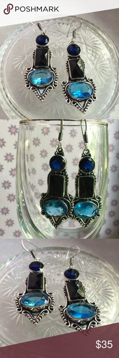 Gemstone earrings NWOT Sterling silver and black onyx earrings with blue Quartz/blue topaz stones. Irregularities are to be expected with natural gemstones. Jewelry Earrings