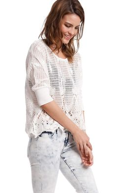 A boxy cover-up of cotton crochet offers an airy layer with a delicate quality. Layer with a lacy...