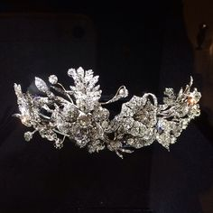 Diamond tiara, set with rose and round cut diamonds and in gold, silver. The…