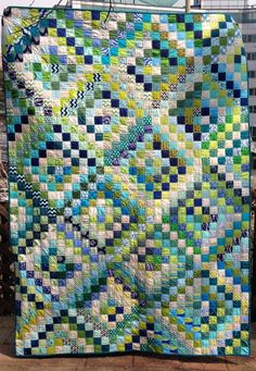 Scrappy Trip Around the World quilt by Spoolbeans