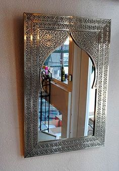 Moroccan hand carved mirror.