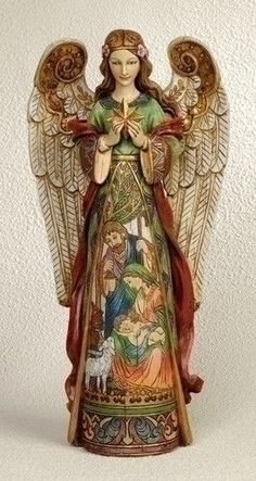 "Angel With The Holy Nativity In The Skirt Statue Beautiful depiction of the Nativity in the skirt of the angel. Made of resin and stone mix. Measures 15.75""H 7.5""W 4""D Hand painted and great attention"