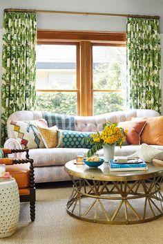 If your living room doesn't feel inviting, cozy it up with a pile of pillows. Gather throw pillows from around the house and arrange them on a sofa to add comfort and color. #decorideas #upcycledecor #homedecor #livingroom #bhg