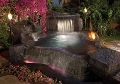 Awesome Tiki Torches for Outdoor and Garden : Tiki Torches Add To The Natural Ambiance Of The Waterfall Pool