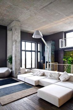 Home Loft Apartment Design by Group Minimalist Interior Design For Living Room With White Sectional Sofa arch lamp and grey rug Interior Exterior, Interior Architecture, Room Interior, Apartment Interior, Cafe Interior, Deco Salon Design, Interior Design Minimalist, Contemporary Interior, Minimalist Architecture