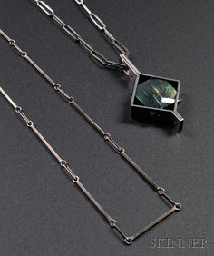 20TH CENTURY DESIGN - SALE 2626B - LOT 79 - , KAUNIS KORU NECKLACE AND CHAIN, SILVER AND LABRADORITE, PAPER CLIP-STYLE CHAIN WITH LABRODRITE PENDANT IN A GEOMETRIC FRAME; ACCOMPAN - Skinner Inc