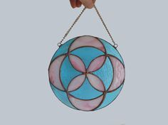Round stained glass panel in sky blue and pink colors with a copper finish. This geometric design glass artwork is bounded in fabulous ornament with a hint of sacred geometry. It is unique and the colors will never fade, so its ideal both as window decoration or wall decor for you home. Its diameter is 20 cm (approx. 8). --------------------------------------------------------------------------------------------- More decorations and panels in my shop: http://etsy.me/1MzFhKN Ba...