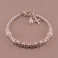 Name bracelet sterling silver newborn girl bracelets for Baby jewelry near me