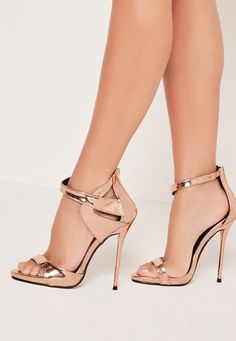 We're all about rose gold right now, so forget light glimmer, it's all about high-res metallics to add to your shoe haul. Featuring an asymmetric strap, barely there style and a luxe rose gold hue, you'll be adding a techy touch to your sty...
