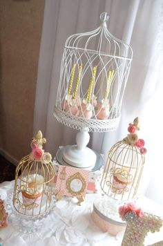 Bird cage decorations at a vintage romantic baptism  party! See more party planning ideas at CatchMyParty.com!