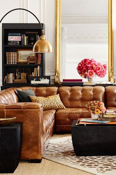 Handsome room created by Ken Fulk for Pottery Barn, but I don't think that they carry any of this. Still, we can steal the ideas. LOVE the gold mirror and the leather sectional is soooo handsome!
