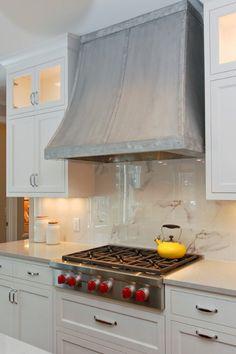 range hood, upper glass cabinets with light